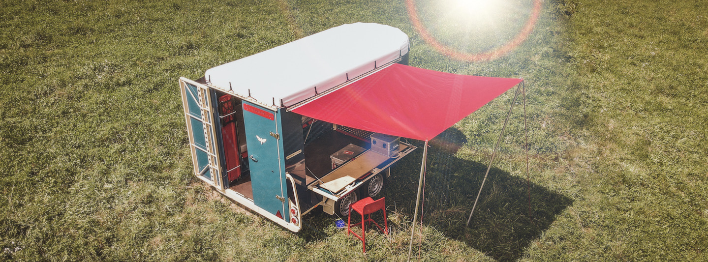 outdoor trailer with sun sail